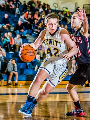Abby Nakfoor and Class A No. 4-ranked DeWitt have won 11 straight entering district play.