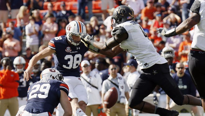 Vanderbilt's Zach Cunningham, right, blocks a field-goal attempt of Auburn's Daniel Carlson on Nov. 5, 2016.