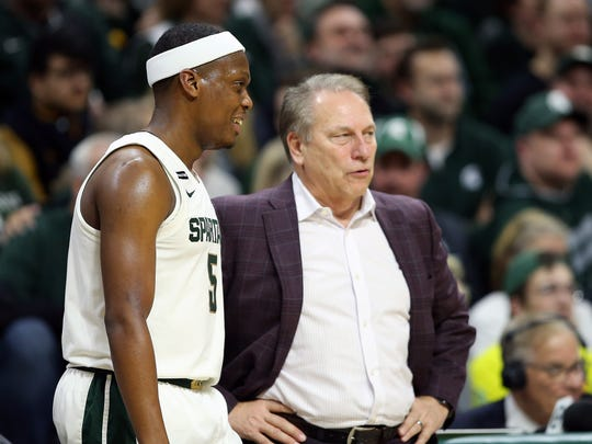 Dec 21, 2019; East Lansing, MI, USA; Michigan State Spartans head coach Tom Izzo  talks to Michigan State Spartans guard Cassius Winston (5) during the second half of a game at the Breslin Center. Mandatory Credit: Mike Carter-USA TODAY Sports