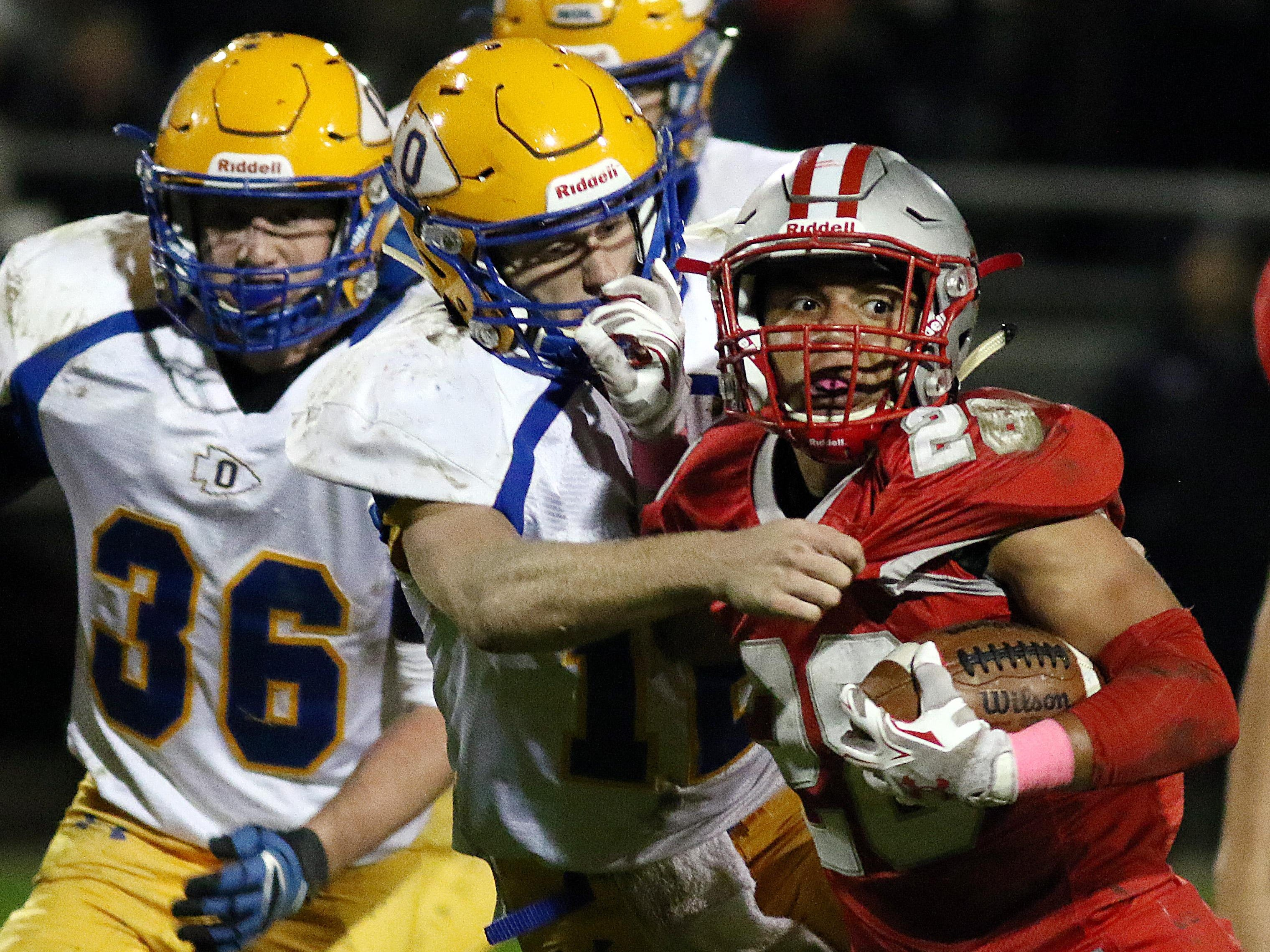Shelby's Devon Brooks breaks some tackles during their game Friday night against Ontario.