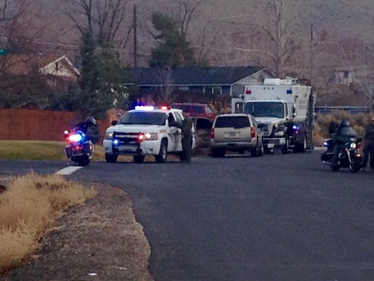 Washoe County Sheriff's deputies have surrounded a home in Lemmon Valley where a man, believed to be involved in a shooting Sunday, has barricaded himself inside.