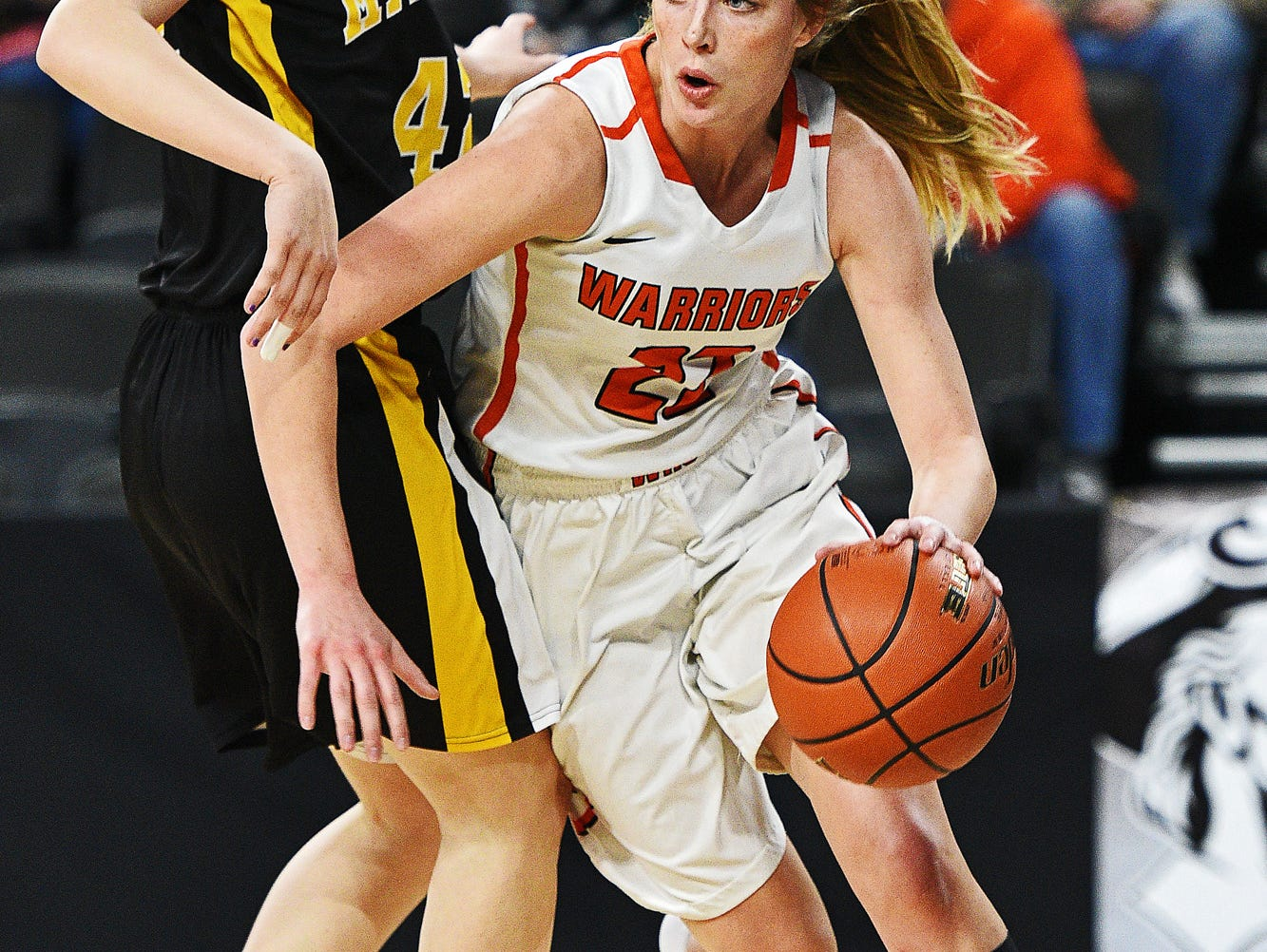 Washington's Anna Goodhope (22) drives past Mitchell's Mackenzie Miller (42) during a South Dakota Class AA State Girls Basketball Tournament quarterfinal game Thursday, March 17, 2016, at the Denny Sanford Premier Center in Sioux Falls.