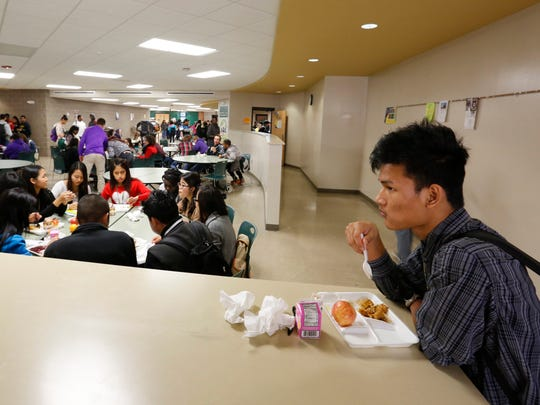 Freshman Sang Tea, 16, eats lunch at Hoover High School. Hoover has one of the most racially diverse student bodies in Iowa.