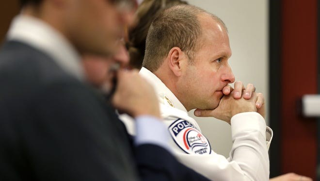 Hortonville Police Chief Michael Sullivan listens Wednesday to testimony during the first day of a hearing before the village's Police Commission.