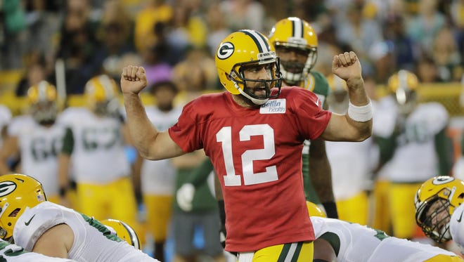Green Bay Packers quarterback Aaron Rodgers communicates before the snap during Family Night at Lambeau Field.