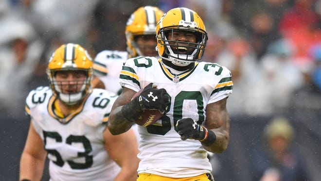 Green Bay Packers running back Jamaal Williams (30) celebrates after gaining yardage during the second half against the Chicago Bears at Soldier Field.