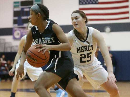 Freshman point guard Marianna Freeman of Bishop Kearney drives past Mercy's Katie Titus last season. Freeman is a sparkplug with long shooting range for the Kings.