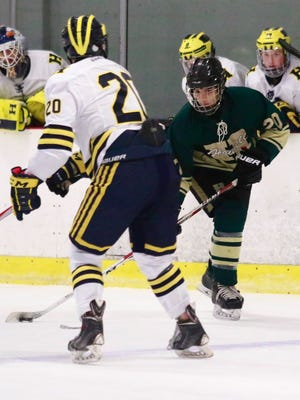 Wes Smith (right) had one of Howell's goals in a 4-3 victory over Northville.