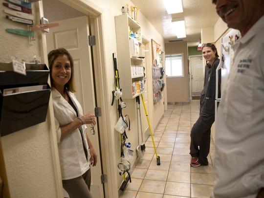 Veterinarian Margie Alvarez, left, veterinarian assistant Sarah Wood and veterinarian Darren Woodson are part of the staff at the Valley Veterinary Clinic in Farmington.