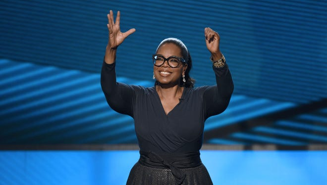 """Oprah greets the crowd at ABC's """"Taking the Stage: African American Music and Stories That Changed America"""" special, airing Thursday."""