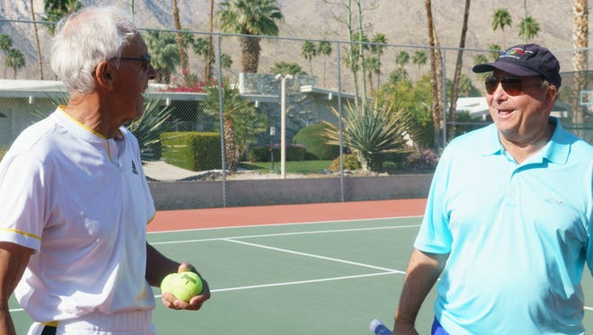 Norm King and Vic Adams exchange laughs during a break in play, February 22, 2018.  The two have been playing tennis together regularly in Palm Springs for the past 29 years.