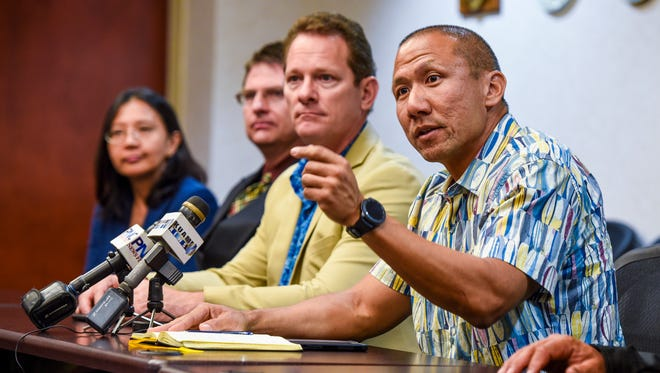 Kevin Rho, right, U.S. Postal Inspection Service assistant inspector in charge, talks about the joint effort between federal and local law enforcement agencies in battling the trafficking of drugs via the U.S. Postal Service into Guam and the Commonwealth Northern Mariana Islands, during a press conference in Hagåtña on Wednesday, Oct. 25, 2017.