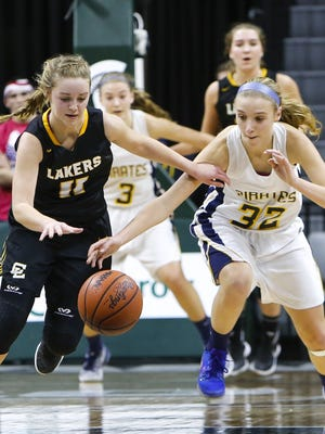 P-W's Emily Spitzley tries to take the ball away from Allie Bonzelet of Maple City Glen Lake Thursday, March 16, 2017, during the Class B Semifinal at the Breslin in East Lansing.