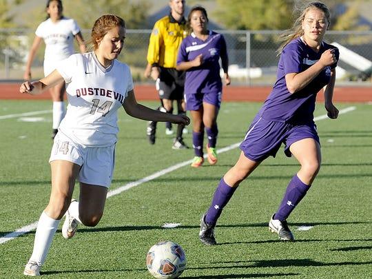 Defender Dayton's Ashley Guadarrama moves past Yerington's Alexus Bodenstein.
