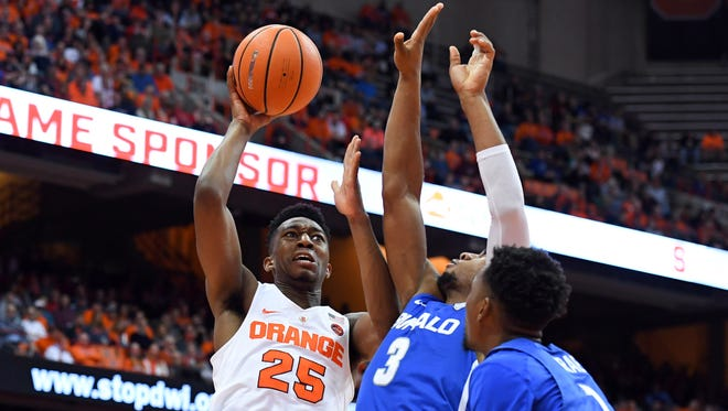 Syracuse guard Tyus Battle (25) drives to the basket against Buffalo guard Jayvon Graves during the second half Tuesday at the Carrier Dome.