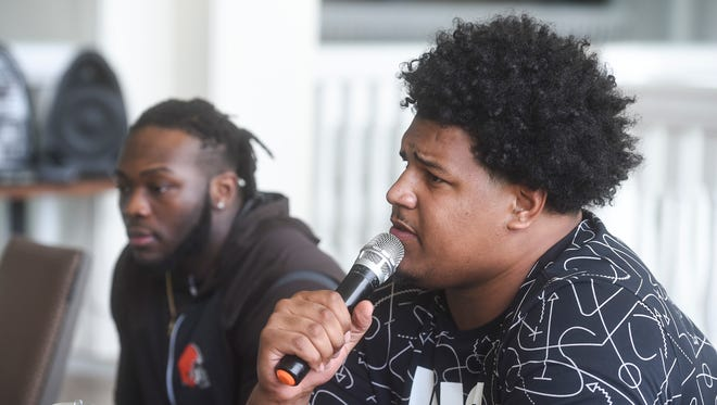 In this file photo from January 2018, Zach Banner, right and Larry Ogunjobi talk at a news conference at the Sheraton Laguna Guam Resort. The two will spend this weekend on Guam, offering free football and coach clinics at Guam High School.