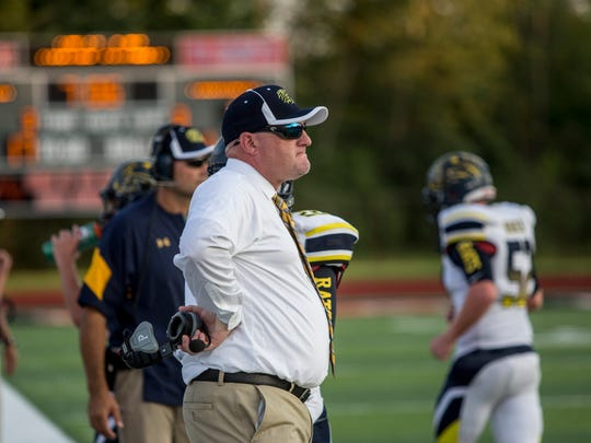 Algonac coach Scott Barnhart watches the action during a football game Thursday, August 25, 2016 at East China Stadium.