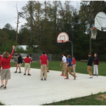 Students play on the new basketball court at South Forrest Attendance Center.