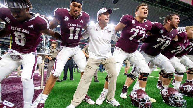 Texas A&M head coach Jimbo Fisher celebrates with his players after defeating Arkansas 24-17 in an NCAA college football game Saturday, Sept. 29, 2018, in Arlington, Texas. (AP Photo/Jeffrey McWhorter) ORG XMIT: CBS123
