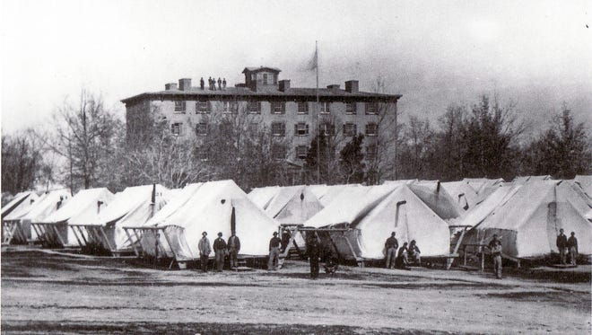 Marine Hospital, was located on the banks of the Ohio River and Ohio Street where, during the times of greatest demand for medical care, a makeshift medical camp was added to the hospital grounds in the form of makeshift tents.