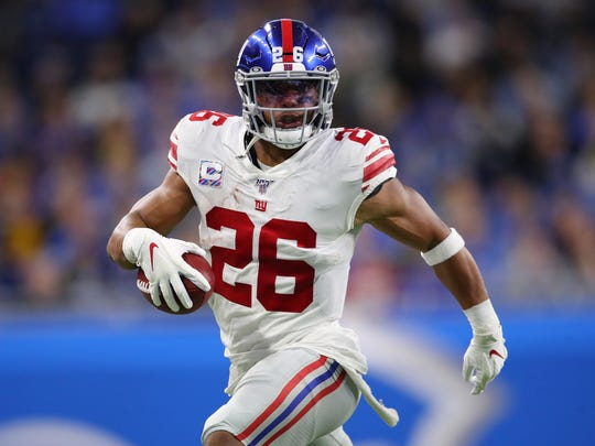 DETROIT, MICHIGAN - OCTOBER 27: Saquon Barkley #26 of the New York Giants looks for running room against the Detroit Lions in the first half at Ford Field on October 27, 2019 in Detroit, Michigan. (Photo by Gregory Shamus/Getty Images)