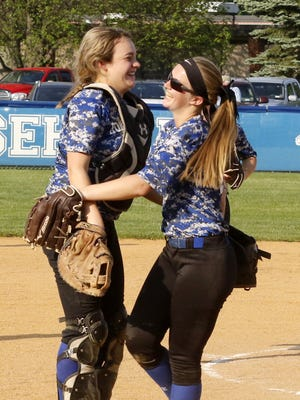 Horseheads catcher Abbey Whitney, left, and pitcher Jenna Richmond celebrate after a 9-5 win over Elmira on Wednesday in the Section 4 Class AA semifinals at Horseheads.