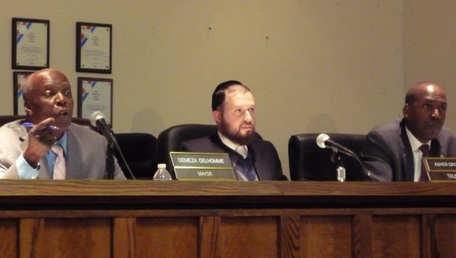 Spring Valley trustees rejected Mayor Demeza Delhomme's attempt Monday to allocate more than $600,000 to hire additional code enforcement officers. From left, Delhomme, Trustees Asher Grossman and Vilair Fonvil.
