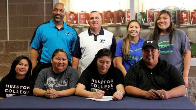 Piedra Vista's Naomi Smith signs her letter of intent on Thursday to join Hesston College's women's basketball program.