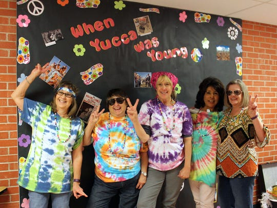 Connie Hare, Carol Matthews, Connie Hinrichs, Sukie Rivera, and Leona Danley, all former and current educators at Yucca Elementary pose together.