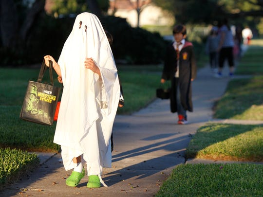 Siler Doane, 9, haunts for candy Wednesday, Oct. 31, 2012 along Del Mar Boulevard on Halloween night in Corpus Christi.