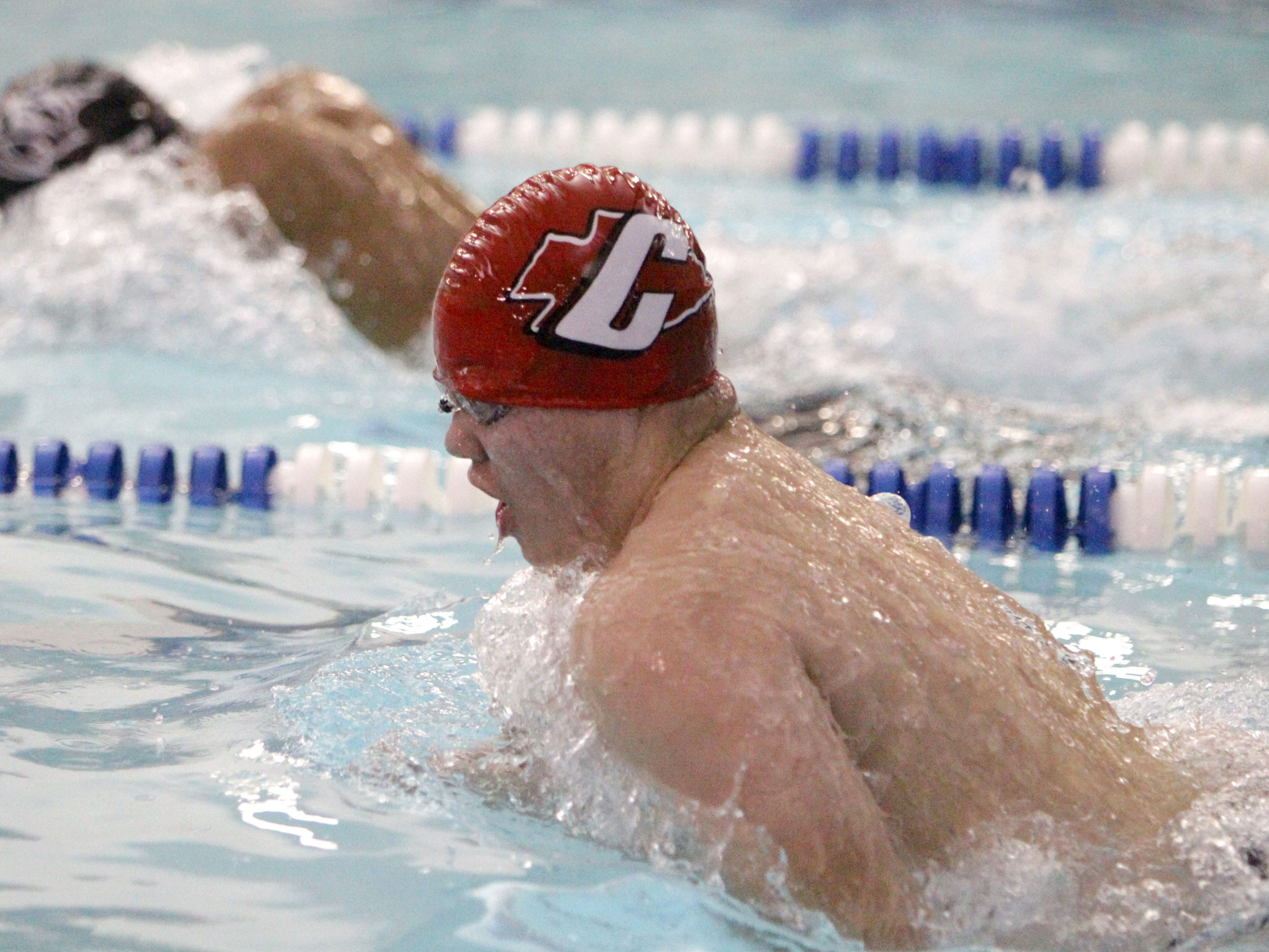 Canton's Cole Malhoit swims his leg of the 200 medley relay.