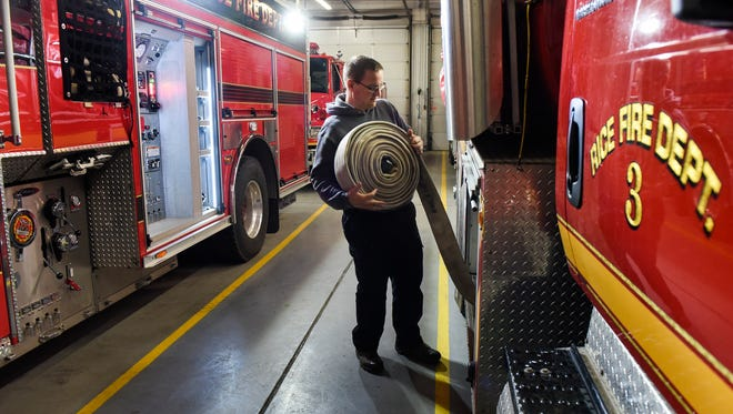 Chief Scott Janski checks emergency equipment on the fire trucks Friday, Dec. 8, at the Rice Fire Department.