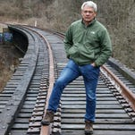 Jay Andress of Hyde Park stands on the train trestle in Ault Park near Old Red Bank Road. In 2011, Andress began an effort to get the Wasson Way bike and pedestrian trail built. It would be a 6.5-mile trail that connects Xavier University with the Little Miami Scenic Trail in Newtown.