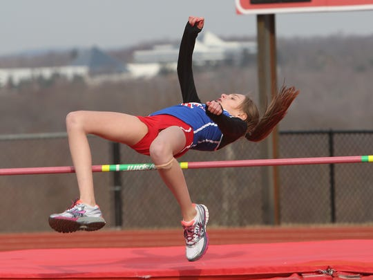 Pearl River's Kayleigh Miedreich clears the bar in the girls high jump during the annual Tusker Twilight Invitational track meet at Somers High School March 27, 2014.