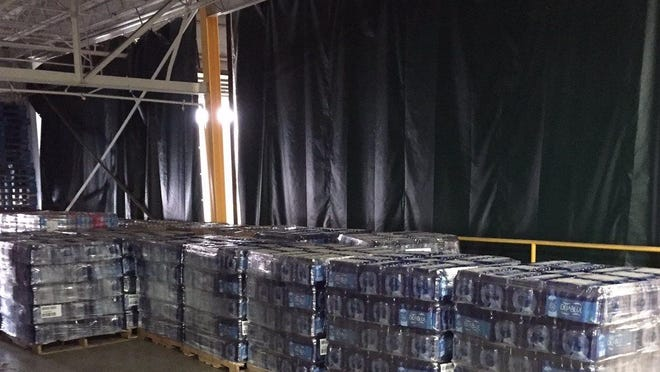 Diana Hussein of Dearborn swapped her old Twitter handle, @DietDrPepper, for around 41,000 bottles of water to help Flint.