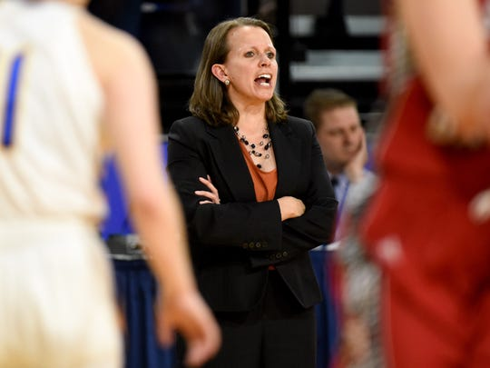 USD's Dawn Plitzuweit reacts to her players while they