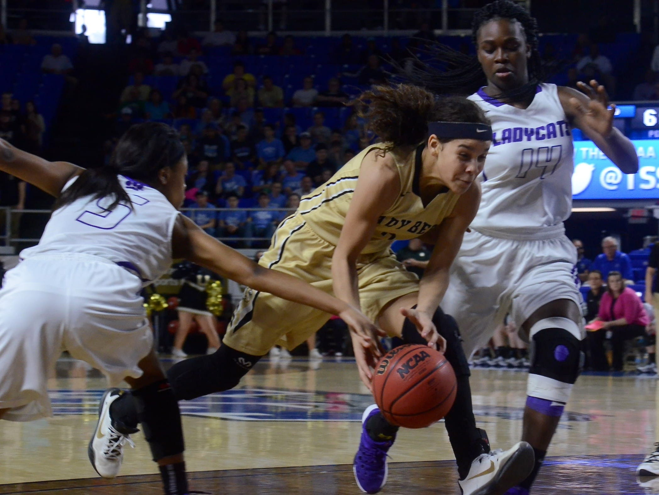 Upperman sophomore Akira Levy (2) dribbles through traffic during Thursday's Class AA quarterfinal against Haywood at MTSU's Murphy Center.