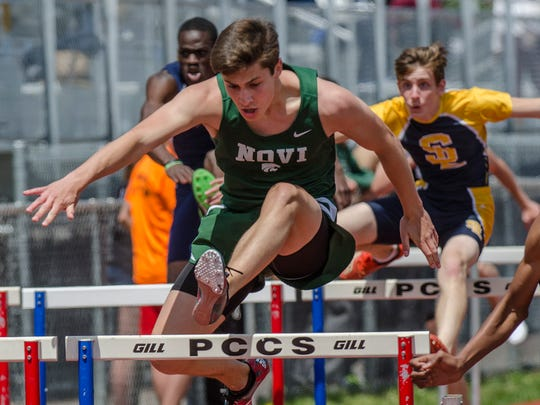 Competing in the preliminary of the 110-meter high hurdles is Novi's John Stefan.