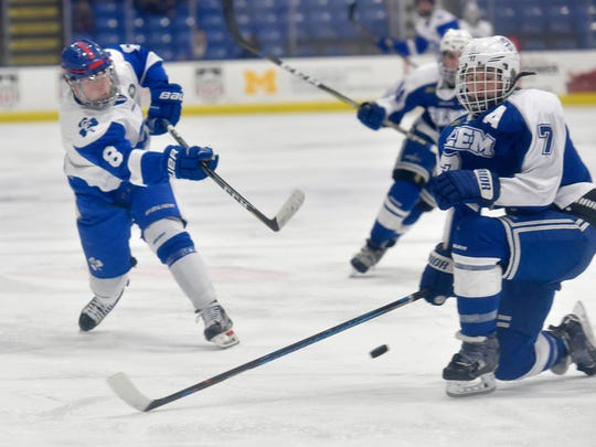 Catholic Central's Joe Borthwick (8) blasts a shot
