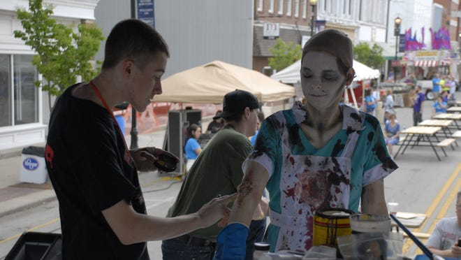 Monster Make-off winner Kyle Dickman creates his lunch lady masterpiece using model Tabbitha Phillips in May 2015.