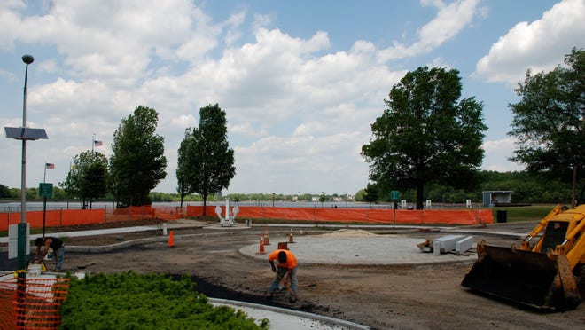 Construction on a roundabout for improved traffic flow in Burlington City is nearing completion at the foot of High Street, which dead ends into the downtown Promenade along the Delaware River (in the background). The circle will allow drivers to make a U-turn on High Street.