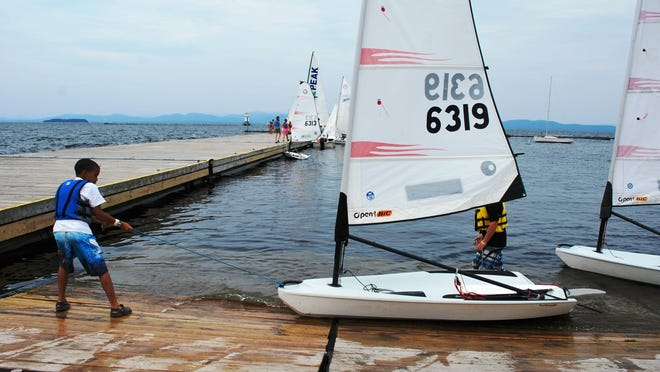 Sailors prepare to head out during Summer Sailing Camp at the Community Sailing Center on Lake Champlain in Burlington in 2013.