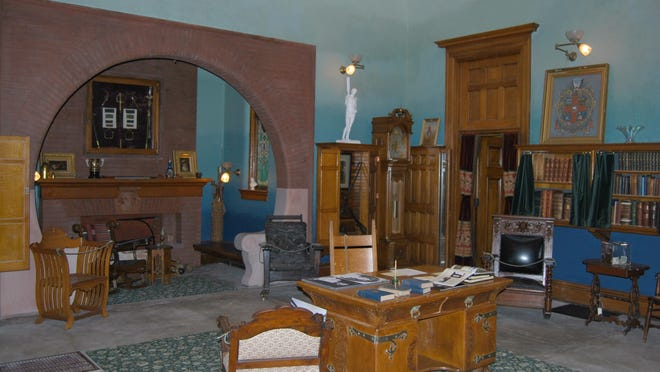The study includes an inglenook with gas-fired fireplace. Above the mantel are some of General Wallace's Civil War memorabilia.