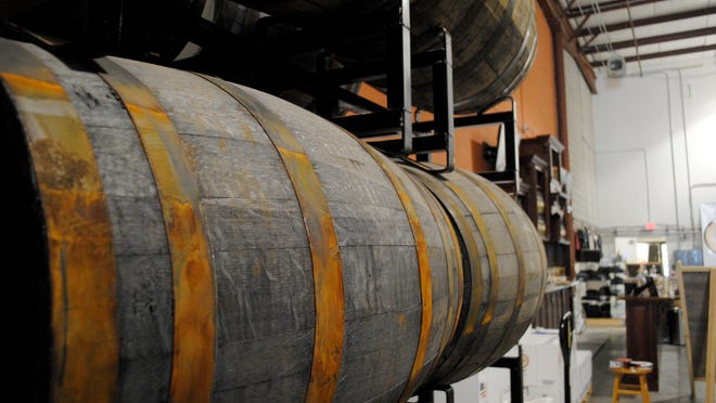 Only two stands of barrels are propped against the wall of Blackwater's distilling facility for now, but more will be added to the collection. The company does not plan to open them for two or three more years for bottling.