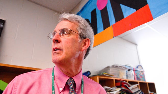 John Bossange, longtime co-principal of Shelburne Community School, looks down the hallway as students move between classes, May 26, 2010. Bossange retired at the end of that year after working with middle school students for more than 30 years.