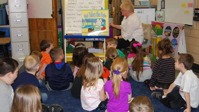 Summerside Elementary School kindergarten teacher Lori Huntington teaches reading skills to youngsters in her class. The next phase of a facility plan for the district includes replacing both Summerside and Willowville elementary schools as well as renovating Clough Elementary School.
