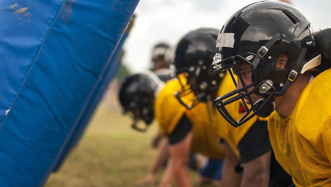 Thomas Tyson readies for a drill Thursday, Aug 11, during football practice at Capac High School.