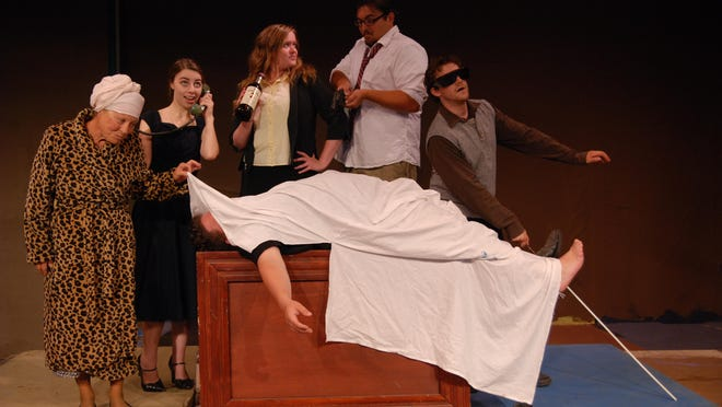 "Carolyn Clinton, Elizabeth Wentzel, Emilee Caughel, Jake Buckley, and Gino Fracassa gather around the corpse (Bruce McFadden) in the morgue in The Barn Theatre's final play of the season, ""Red Herring."" Three love stories, a murder mystery, and a nuclear espionage plot converge in this comedy. ""Red Herring"" runs Aug. 25-27 and Sept.1-3 at The Barn Theatre in Port Sanilac."