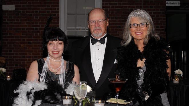 Executive Director Linda Moore at the Morris Museum's Gatsby Gala with William Stack and Chair Donna Stack.