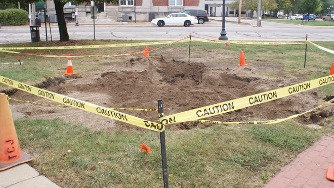 The large sinkhole in front of the Tazewell County Justice Center in Pekin has been back filled, but holes of this type have been a recurring issue on the site, possibly due to debris left behind from the demolition of a previous building.